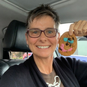 Veronica Carroll - Children's Health Foundation of Vancouver Island CEO holding Tim Hortons Smile Cookie